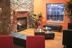 Cozy retail waiting and lounge area by Paramount Construction and Contracting
