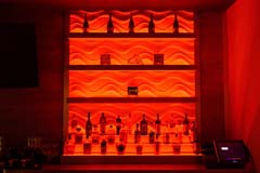 Banquet hall bar with red LED controllable lighting by Paramount Construction and Contracting