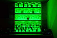 Banquet hall bar with green LED controllable lighting by Paramount Construction and Contracting