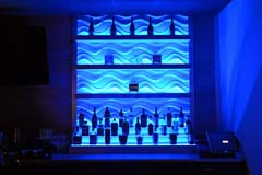 Banquet hall bar with blue LED controllable lighting by Paramount Construction and Contracting