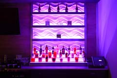 Banquet hall bar with purple LED controllable lighting by Paramount Construction and Contracting