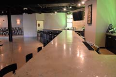 Banquet hall bar with quartz granit bar by Paramount Construction and Contracting