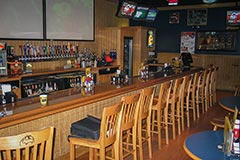 Beautiful bar woodwork for restaurants by Paramount Construction and Contracting