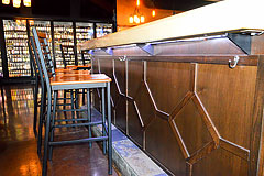 Custom wood work for commercial bar by Paramount Construction and Contracting