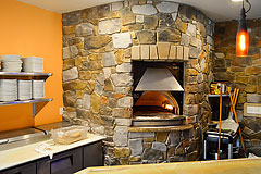 Custom stone work for stone brick oven by Paramount Construction and Contracting