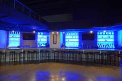 Banquet hall bar with LED controllable lighting by Paramount Construction and Contracting